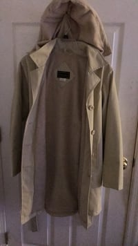 Color: Tan/Cream: Buttoned up coat for rain and snow, inside pockets with hoodie: size(small) Inside lining. Wore twice: Condition: Like New : Laurel, 20723