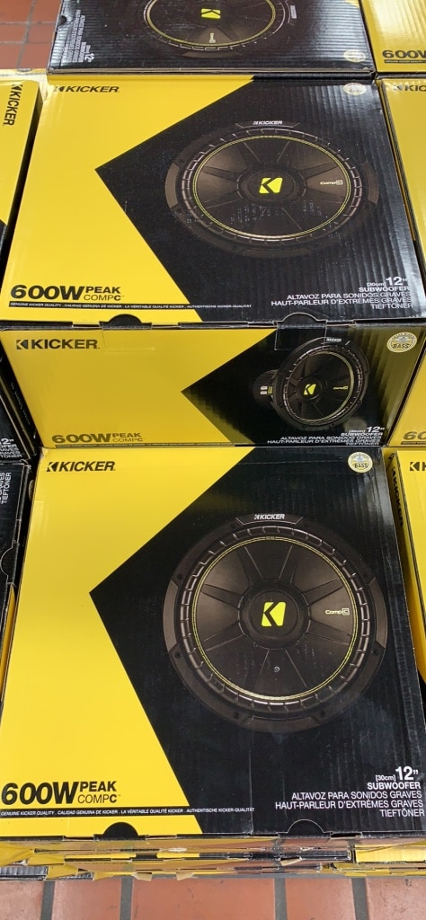 Photo Black and red kicker subwoofer with box