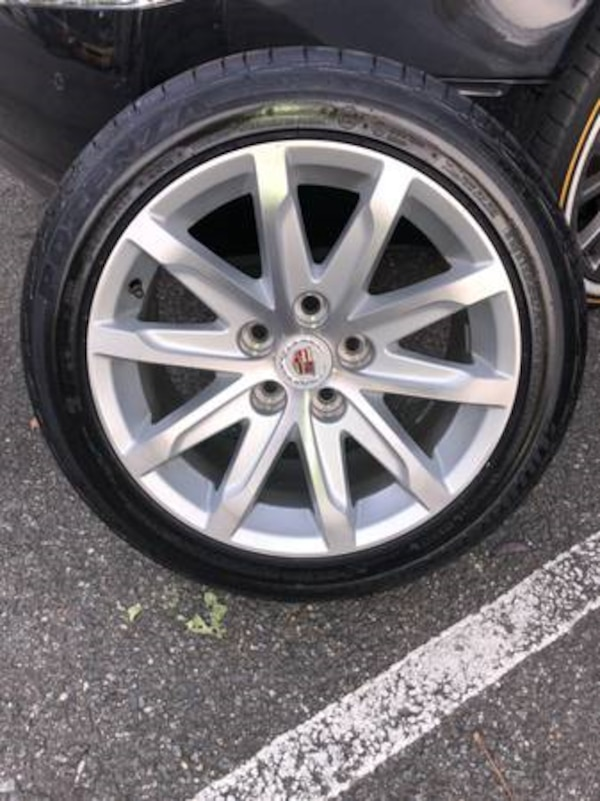 4 CADILLAC RIMS WITH TIRES