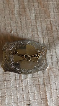 silver-colored embossed belt buckle 2286 mi