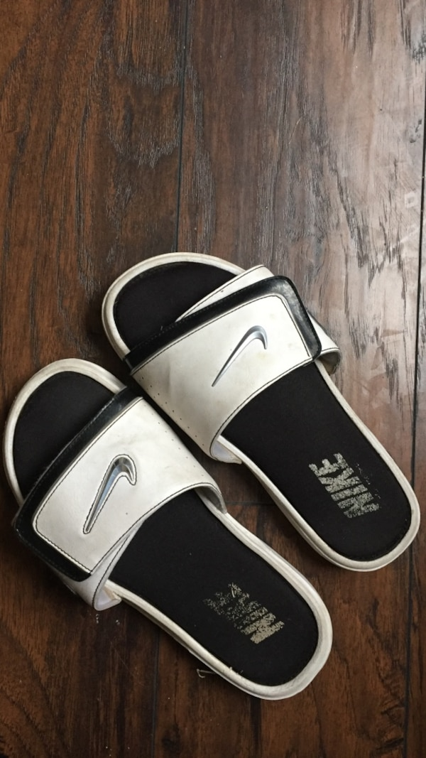 93afe2cb93e2 Used pair of white-and-black Nike slide sandals for sale in Calhoun ...