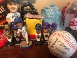 Tons of Boxes and Binder full of vintage baseball and football cards and booble heads and signed baseball and plate