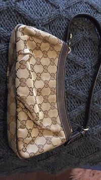 Brown monogrammed Gucci- brand new condition  Vancouver, V6Z 1X9