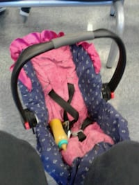 baby's black and pink car seat carrier Garden Grove