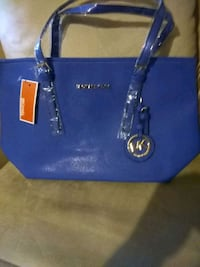 Used blue Michael Kors leather tote bag for sale in North Little Rock ... f617d0b9242b1