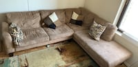 brown suede sectional sofa with throw pillows New York, 10010