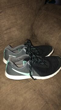 Pair of black-and-white nike running shoes Northport, 35475