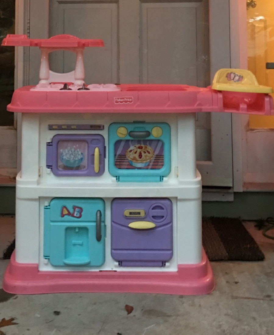 Used pink white and purple fisher price kitchen counter toy in ...