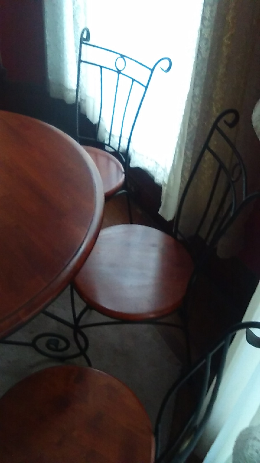 Table and four chairs - Evansville