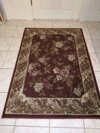 brown and white floral area rug Seminole, 33772