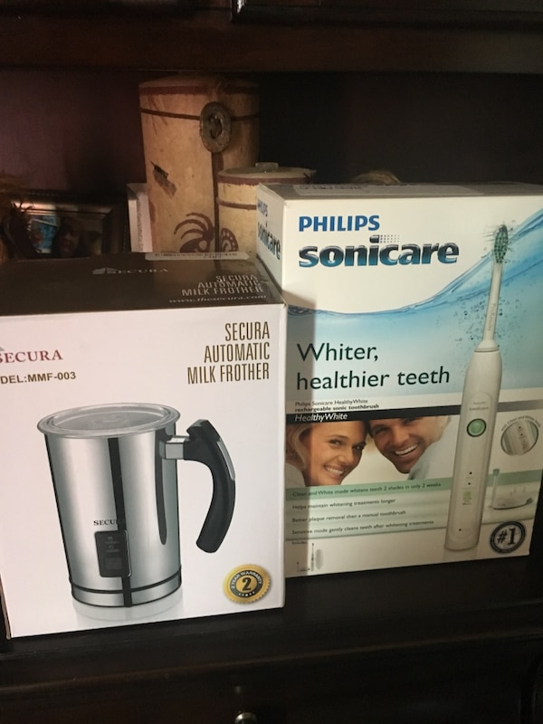 white Philips Sonicare automatic toothbrush box