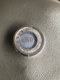 Round silver and gold coin Costa Mesa, 92627