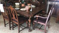 brown wooden framed dining table with chairs set