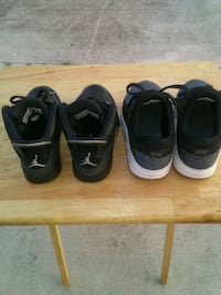 two pairs of black Nike shoes New Iberia, 70563