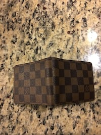 black and brown leather checkered bifold wallet