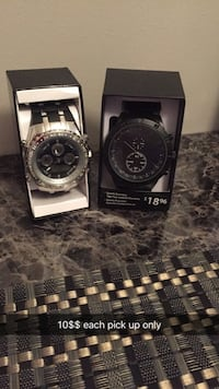 two round silver and gold chronograph watches Saskatoon, S7M 0T7