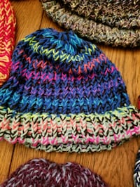 blue, yellow, and pink knit cap 1035 mi