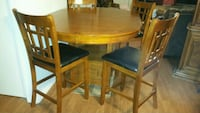 round brown wooden table with four chairs dining set Tucson, 85706