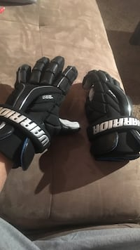 Two pairs of lacrosse gloves Langley