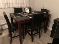 rectangular brown wooden table with 8 chairs dining set Mississauga, L5M
