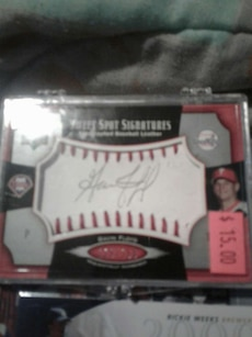 white and gray signatures baseball case