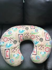 Baby's blue, red, and brown bird print nursing pillow