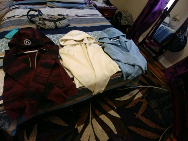 three assorted-color pull-over hoodies