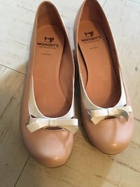 pair of pink leather flats Vancouver, V6G 2H1