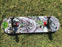 White, green, and black skateboard Lodi, 95240