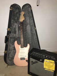 two white electric guitars with black guitar amplifier Toronto, M1V 2Z4