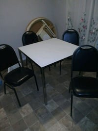 Table glass top and 4 chairs