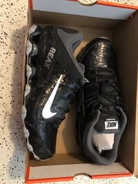 pair of black-and-white Nike cleats Belleview, 34420