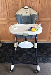 white and gray highchair