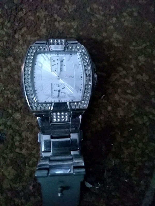 square silver-colored analog watch with link bracelet