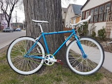 blue fixed gear bicycle