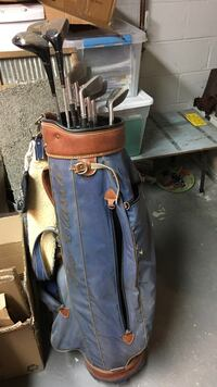 blue and brown golf bag with golf clubs Beltsville, 20705