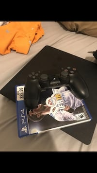 black Sony PS4 console with controller 42 km