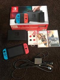 Nintendo Switch with screen protector and games  Kelowna, V1X 1X1