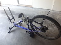 blue and silver hard-tail mountain bike