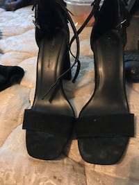 pair of black leather open-toe heeled sandals Surrey, V3R 2K4