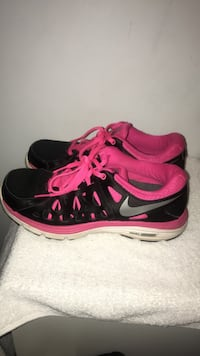 pair of black-and-pink Nike running shoes 41 mi