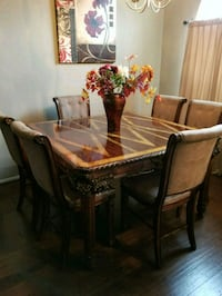 rectangular brown wooden table with six chairs din Pearland, 77584