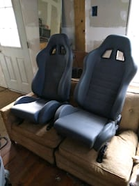 A pair of new racing seats leatherette material double stitched