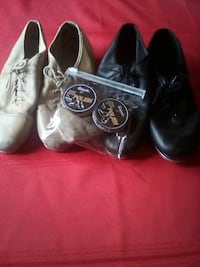 two taupe and black leather shoes