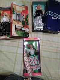 three Barbie doll boxes
