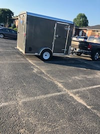 Black and gray enclosed trailer