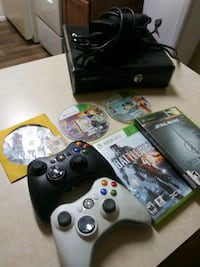 black Xbox 360 game console with game cases Tucson, 85710