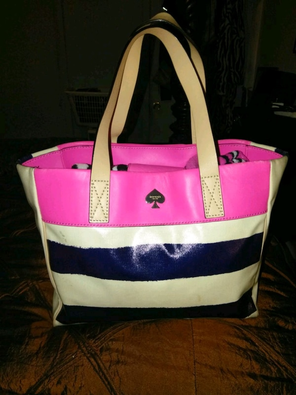 white, pink, and blue leather tote bag