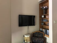 black flat screen TV with white wooden TV stand 3120 km