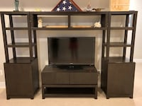 black wooden TV stand with flat screen television Herndon, 20170